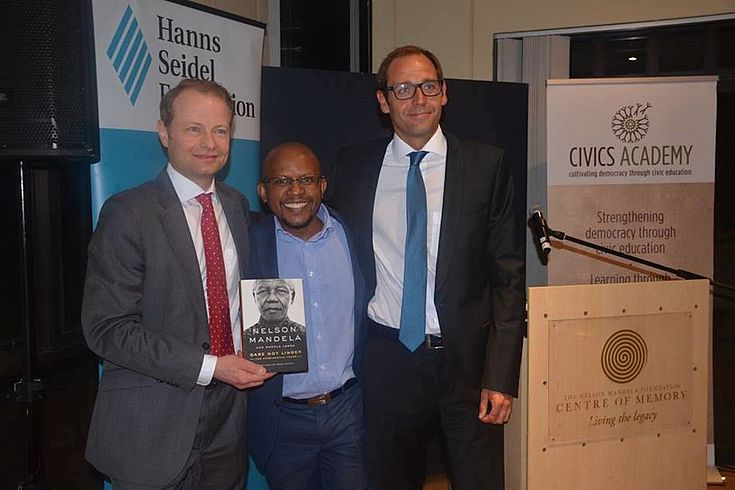 Dr Wolf Krug and Hanns Bühler with Sello Hatang, CEO of the Nelson Mandela Foundation