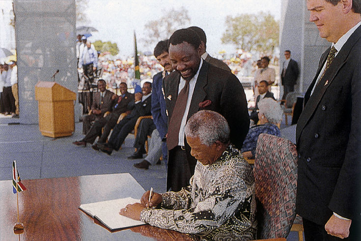 Nelson Mandela signing the new South African Constitution