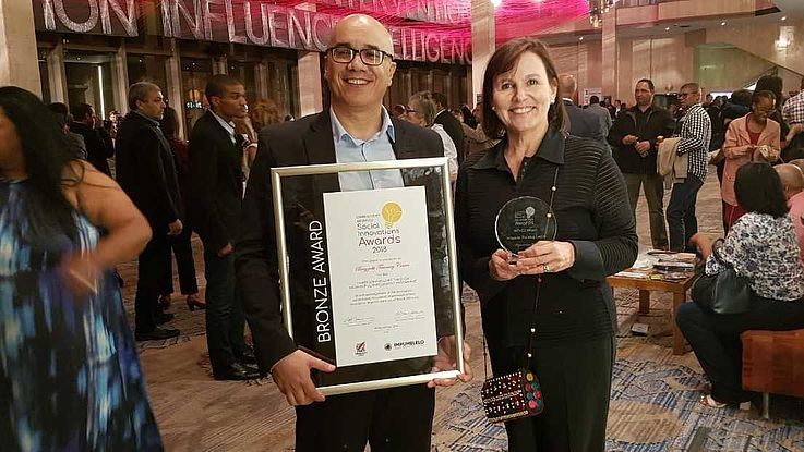 Adrian Bezuidenhout, Training Manager, and CEO Renske Minnaar with the award