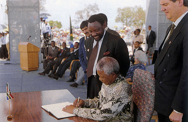Nelson Mandela signing the new Constitution, which became valid in 1996