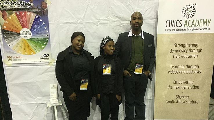 The student facilitators and a representative from the Department of Education