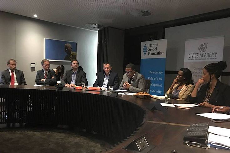 Speakers in the boardroom of the Nelson Mandela Foundation
