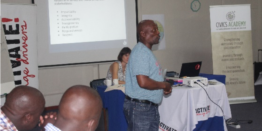 Mr. Moses Pitso from the IEC running a session on the electoral process